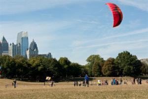 Woman Gets Kite Airborn At Autumn Festival