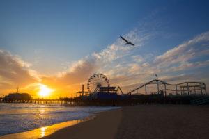 Santa Monica California sunset on Pier Ferrys wheel and reflection on beach wet sand