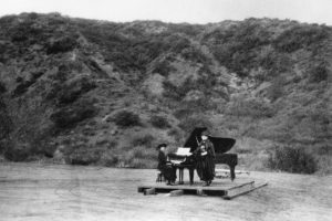 Two_women_performing_on_a_barn_door_in_the_first_known_musical_event_at_the_Hollywood_Bowl_ca.1920_CHS-14567-300x200.jpg
