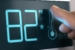 Digital Thermostat Temperature Controller Set at 82 Degrees Fahr