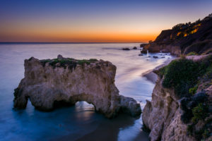 Sea stack and view of the Pacific Ocean at sunset, from cliffs at El Matador State Beach, Malibu, California.