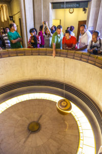 LOS ANGELES, CA - JUNE 10: people admire the Foucault pendulum in Griffith park on June 10,2912 in Los Angeles. The pendulum was installed in 1935 to demonstrate the rotation of the Earth.