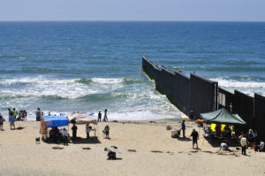 Border fence separating Mexico and the United States at the beach in Tijuana