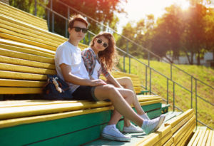 Summer young modern stylish couple in sunglasses rest in the city, hipsters teenagers in urban style, youth, fashion - concept