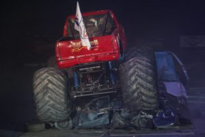 ISTANBUL, TURKEY - JANUARY 31, 2015: Monster Truck Lil Devil crush to old cars in Sinan Erdem Dome during Monster Hot Wheels stunt show.