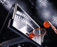 Player throws the ball in the basket