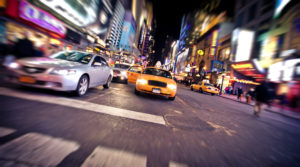 NEW YORK - JANUARY 6: Blurred image of yellow taxi cab on January 6, 2011 in Times Square and 42nd Street, Manhattan, New York City